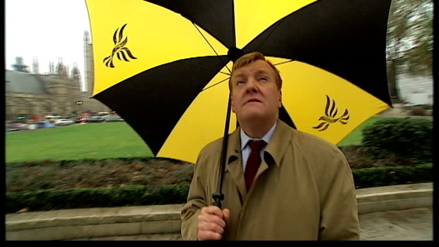 charles kennedy view england london westminster overlay unidentified classical music charles kennedy mp stands in parliament square looking at statue... - paddy ashdown stock-videos und b-roll-filmmaterial