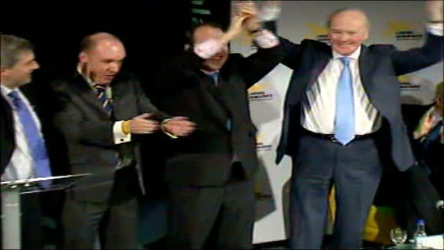 contenders begin campaigning england london liberal democrat leadeship contenders lined up on stage waving to audience from lr chris huhne mp mark... - sir menzies campbell bildbanksvideor och videomaterial från bakom kulisserna