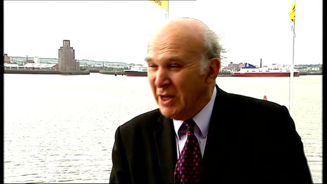 liberal democrat party conference: nick clegg tells party to hold its nerve; england: merseyside: liverpool: ext vince cable mp interview with... - doing a favour stock videos & royalty-free footage