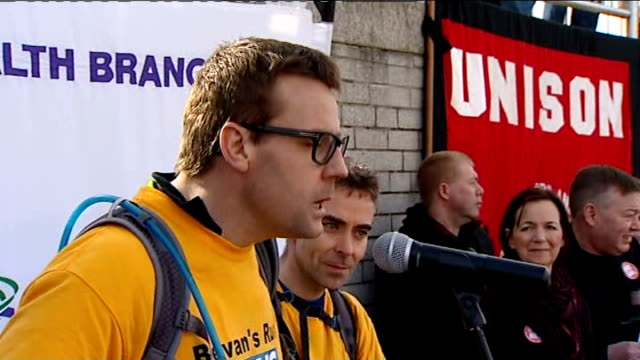 stockvideo's en b-roll-footage met nhs reforms debate avoided england tyne and wear gateshead ext various shots of unite and unison union demonstrators march with placards across... - tyne and wear