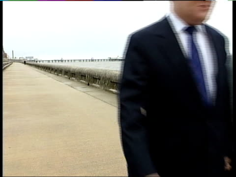 annual conference in blackpool england blackpool ext charles kennedy mp walking along promenade with his wife sarah kennedy - charles kennedy stock videos & royalty-free footage