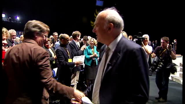 liberal democrats conference: cable attacks banks; vince cable shaking hands with audience members at end of speech - kissing female membners of... - vince cable stock videos & royalty-free footage