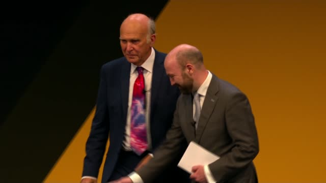 vince cable calls for a 'citizens fund' to spread wealth england east sussex brighton int sir vince cable mp along stage to sit down cable listening - east sussex stock videos & royalty-free footage