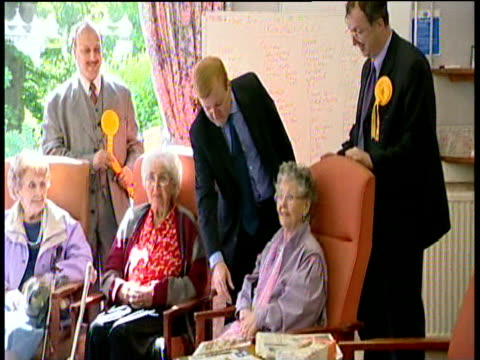 liberal democrats leader charles kennedy kissing lady's hand at a nursing home during campaign trail for general election birmingham 31 may 01 - kissing hand stock videos & royalty-free footage