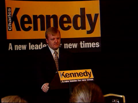 liberal democrats leadership battle itn london charles kennedy mp standing at podium lms kennedy standing in front of 'kennedy a new leader for our... - charles kennedy stock videos & royalty-free footage