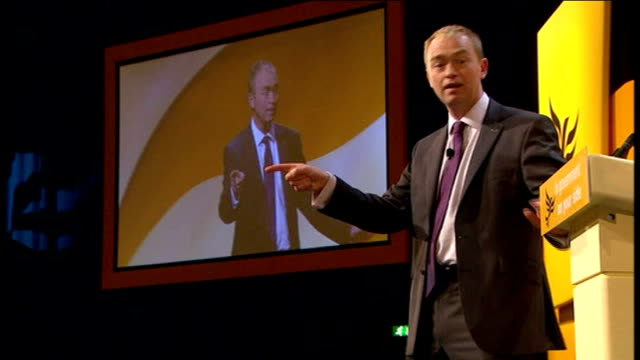 liberal democrats party conference 2011: plans to clamp down on tax avoidance by the wealthy; delegates applauding wide shot of tim farron mp on... - clamp stock videos & royalty-free footage