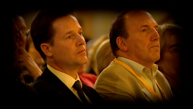 vídeos de stock e filmes b-roll de plans to clamp down on tax avoidance by the wealthy west midlands birmingham liberal democrats conference clegg in audience / wide shot of conference... - west midlands