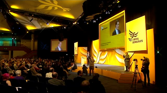 liberal democrats party conference 2011: plans to clamp down on tax avoidance by the wealthy; long shot of danny alexander mp speaking on stage danny... - クランプ点の映像素材/bロール