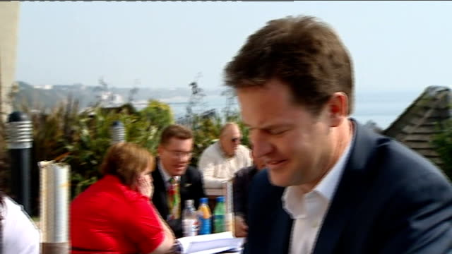nick clegg and wife photocall various of nick clegg and wife miriam gonzalez durantez drinking cups of coffee at outdoor cafe / clegg and wife away... - ニック クレッグ点の映像素材/bロール