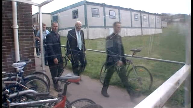 sir menzies campbell defends his leadership lib england sussex brighton campbell along with photographers and others down path at school - sir menzies campbell bildbanksvideor och videomaterial från bakom kulisserna