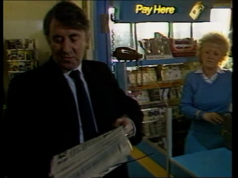 stockvideo's en b-roll-footage met policy document; scotland: edinburgh airport: int cms side david steel picks up newspaper at counter of airport shop cms side steel l-r to bv thru... - david steel politiek