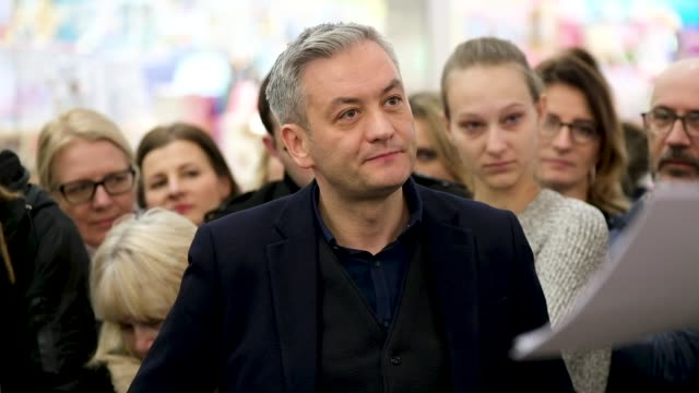 Liberal proEuropean openlygay and charismatic Polish politician Robert Biedron speaks to visitors at an event where he presented his book 'New...