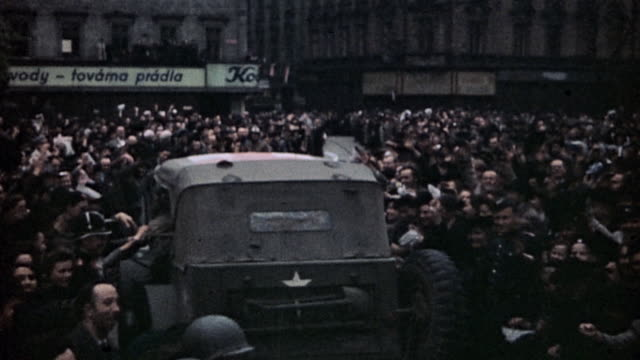pan liberated civilians waving and celebrating in street as 16th armored division ambulance and truck drive by / pilsen czech republic - armored truck stock videos and b-roll footage
