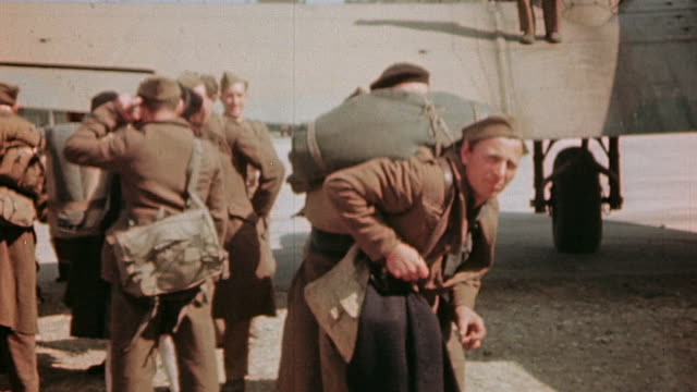 liberated french army soldiers and officers arriving at airport on c47 with luggage one on stretcher / paris france - esercito militare francese video stock e b–roll