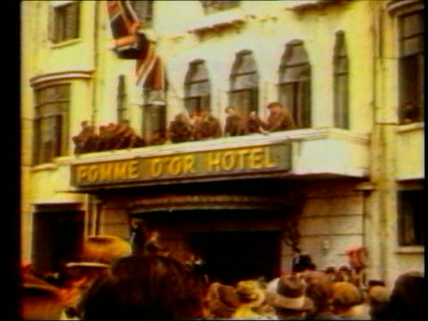 vídeos de stock e filmes b-roll de liberation of channel islands remembered lib pomme d'or hotel building with union jack flying after the liberation from the germans - ilhas do canal da mancha