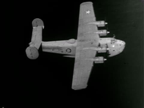 B24 'Liberator' heavy bomber aircraft in flight over water TD WS Three B24s in flight TD MS Front of B24 in flight WWII World War II