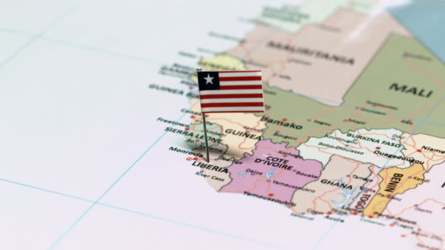 liberia with national flag - continente area geografica video stock e b–roll