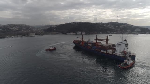 liberia-flagged cargo ship ran ashore of the bosphorus strait in istanbul on friday. the ship, called songa iridium, stranded near the rumeli... - bosphorus stock videos & royalty-free footage