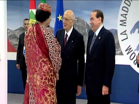 Liberian leader Colonel Muammar Gaddafi is greeted by Italian Prime Minister Silvo Berlusconi ahead of 2009 G8 Summit Italy 10 July 2009