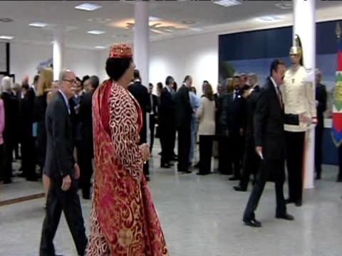 liberian leader colonel muammar gaddafi walks towards italian prime minister silvo berlusconi ahead of 2009 g8 summit italy 10 july 2009 - muammar gaddafi stock videos & royalty-free footage