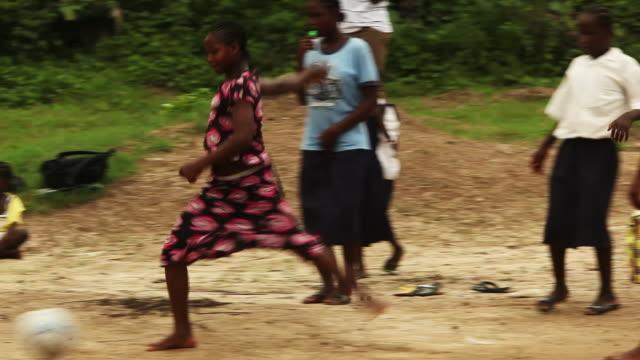 Liberian schoolchildren play kickball