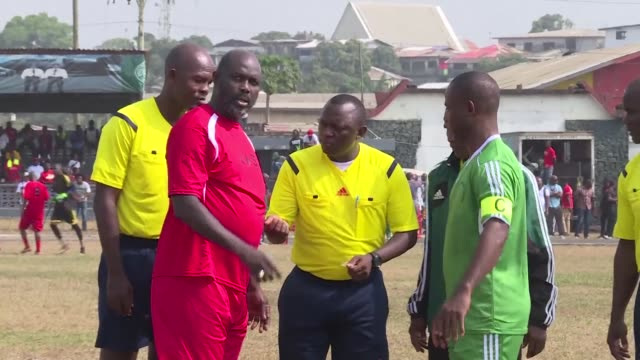 Liberia's president elect and former football star George Weah plays a friendly game against the armed forces