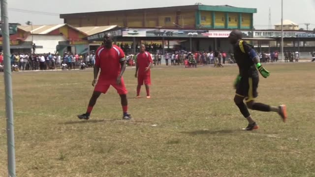Liberia's president elect and former football star George Weah plays a friendly game against the armed forces ahead of his inauguration as the...