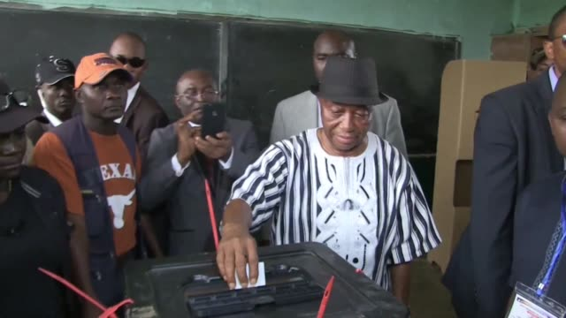 Liberia's vice president Joseph Boakai casts his ballot as he goes head to head with rival candidate former international footballer George Weah in a...