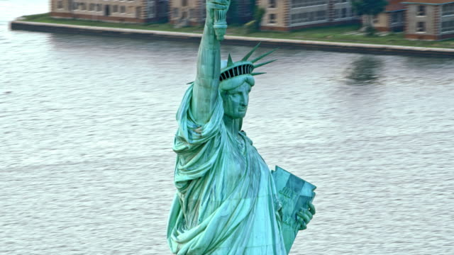 aerial liberty enlightening the world in new york harbor - statue of liberty new york city stock videos & royalty-free footage