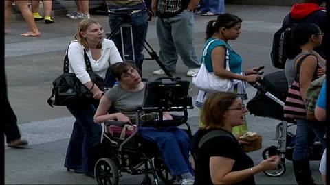 stockvideo's en b-roll-footage met 'liberty' festival in trafalgar square; england: london: trafalgar square: ext general view of 'liberty' festival underway disabled woman pushed in... - festivalganger