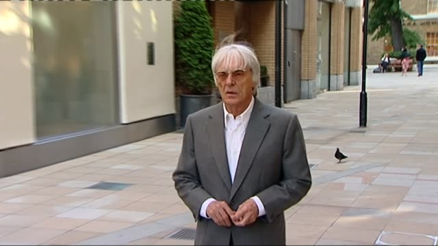 liberty media bids to take over formula one; date unknown england: london: bernie ecclestone along in grey suit as questioned by journalist - bernie ecclestone stock videos & royalty-free footage