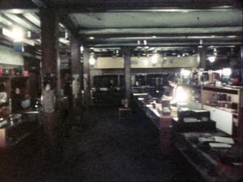 liberty's department store is lit temporarily by lamps during power cuts due to the miners strikes - department store stock videos & royalty-free footage