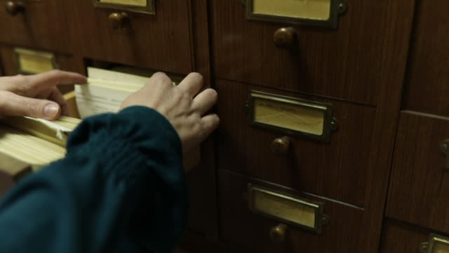 librarian looking for the index card - filing cabinet stock videos & royalty-free footage