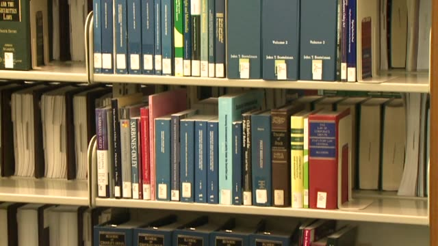 library books on shelf on september 20 2011 in san diego california - bibliothekar stock-videos und b-roll-filmmaterial