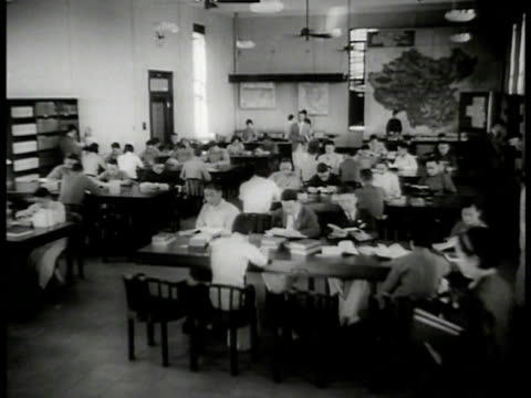 library building int ws chinese people in library lobby ws people at tables reading books ws people looking for books on table ms woman at table... - 1937 stock videos and b-roll footage