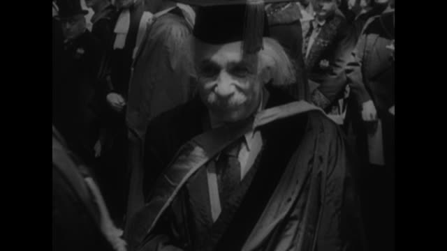 Library material of Albert Einstein used upon his death line of Princeton University graduating class and audience at 1947 commencement near Nassau...