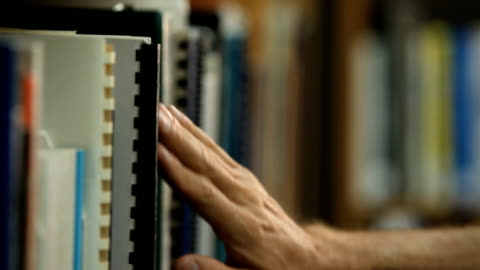 library - taking book off the shelf - library stock videos & royalty-free footage