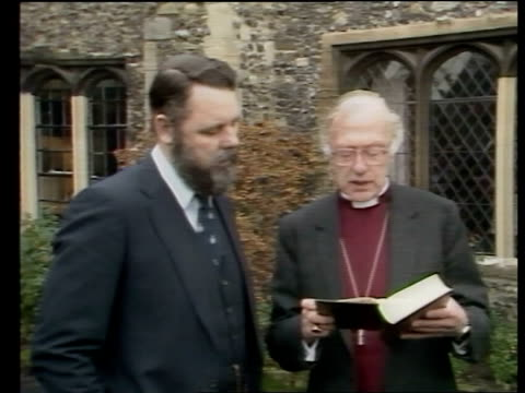 libya detainees; a) england: kent: canterbury: terry waite, archbishop of canterbury's special envoy walks l-r with archbishop of canterbury, dr... - robert runcie stock videos & royalty-free footage