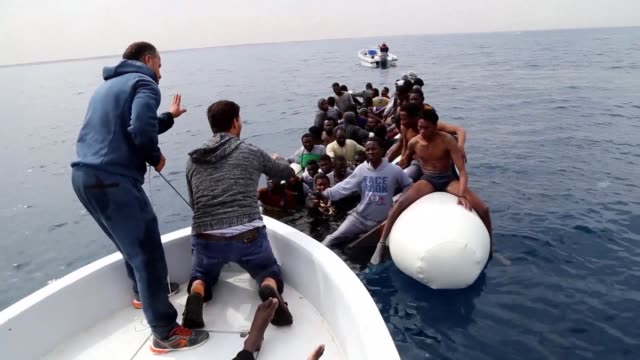 libya has in two days rescued 420 migrants trying to cross the mediterranean to europe a navy spokesman said monday but three were found dead and 30... - az zawiyah stock videos & royalty-free footage