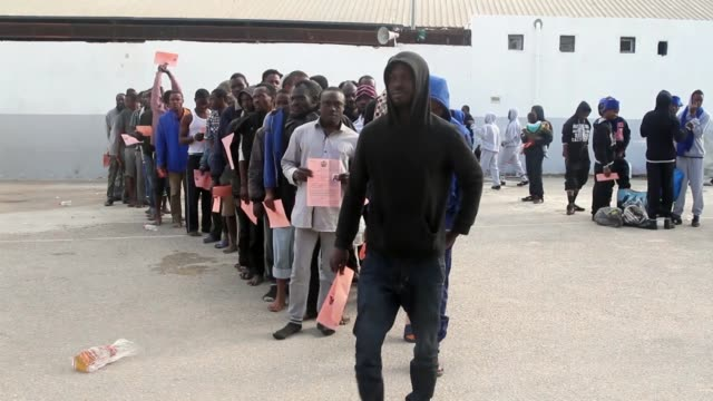 Libyan authorities deport 140 illegal Nigerian migrants back home on November 28 2017 as part of the International Organisation for Migration...