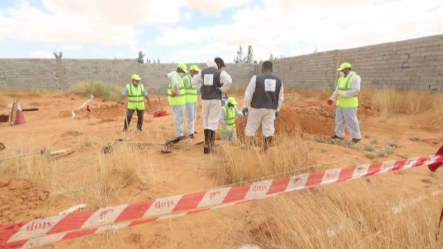 libyan experts search for human remains during the exhumation of mass graves in tarhuna southeast of the capital tripoli an area recently seized by... - strongman stock videos & royalty-free footage