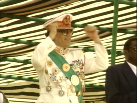 libyan fm visit to london itv lib colonel muammar gaddafi libyan leader raising his fists in victory and applauding at military parade - military parade stock videos & royalty-free footage