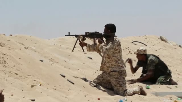 Libyan Government of National Accord forces are seen as they conduct an operation against Daesh terrorists in Sirte Libya on June 25 2016
