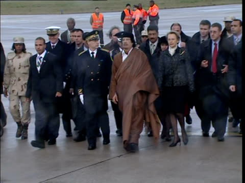libyan leader moamer kadhafi is in paris on a visit slated to bring 10 billion euros of contracts to french companies but which has sparked... - formal reception stock videos and b-roll footage