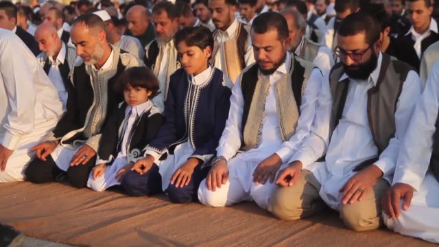 libyan muslims perform eid alfitr prayer at martyrs' square on the first day of threeday eid alfitr festival marking the end of the holy fasting... - eid mubarak stock videos & royalty-free footage