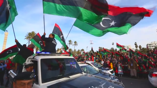 libyan people and security forces celebrate the fourth anniversary of libya's 17 february revolution at the martyrs' square in capital tripoli on... - libya stock videos & royalty-free footage