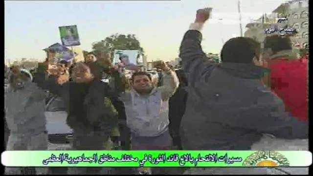 stockvideo's en b-roll-footage met libyan police dispersed an anti-regime protest in the city of benghazi overnight, prompting a show of strength by supporters of libyan leader moamer... - clean