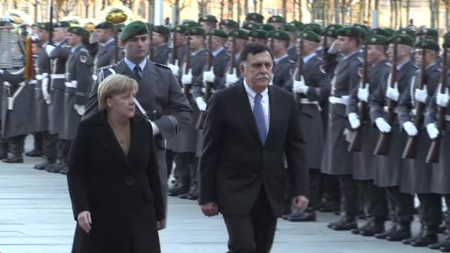 Libyan Prime Minister Fayez alSarraj meets with German Chancellor Angela Merkel at the Chancellery in Berlin Germany on December 07 2017