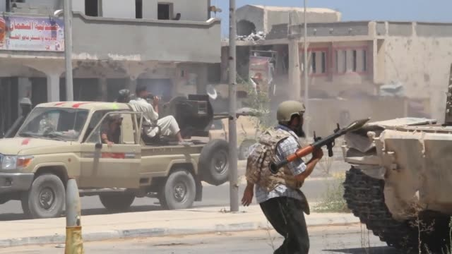 libyan pro government forces press an advance against the islamic state group in the coastal city of sirte on sunday as they battle jihadists holed... - battle stock videos & royalty-free footage