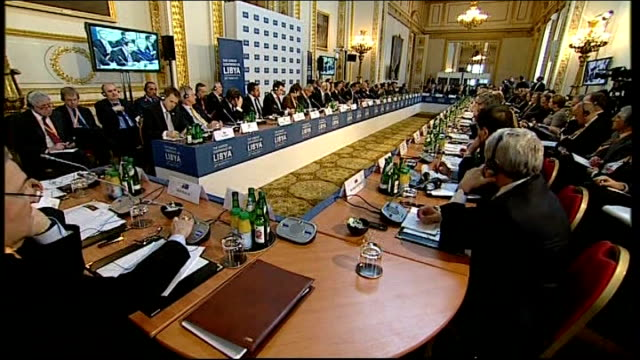 stockvideo's en b-roll-footage met international conference held in london england london lancaster house ext david cameron mp arriving for one day conference on libya with world... - william hague